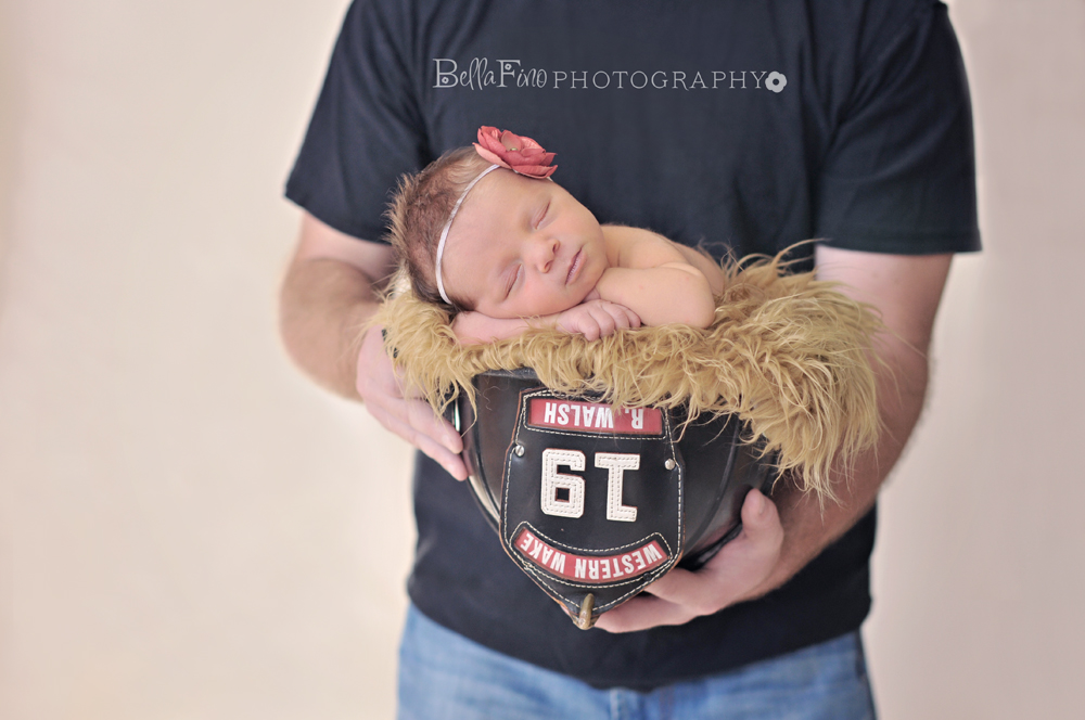 4c66f1e2d Newborn baby girl photographed in dad s firefighter gear in Raleigh ...